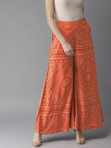 Moda Rapido Women Orange & White Printed Flared Palazzos